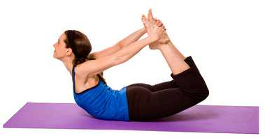 Dhanurasana or ( Bow pose)