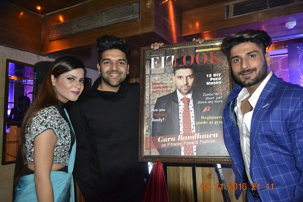 Guru randhawa launched a fitness magazine - he is with a co founders of magazine - 3 people is in this picture. Guru Randhawa wore black attires.