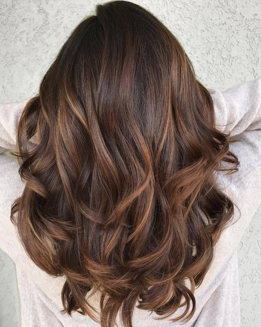 dark brown hair with highlights