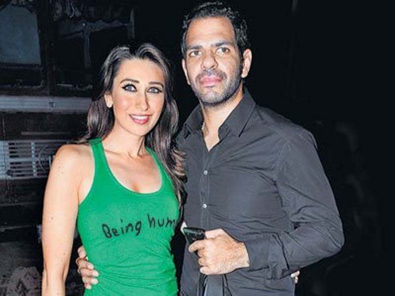 Karishma and Sunjay smiling and posing for camera - famous bollywood divorces