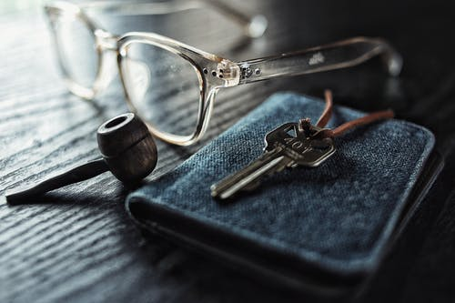 selective focus photo of silver key beside brown