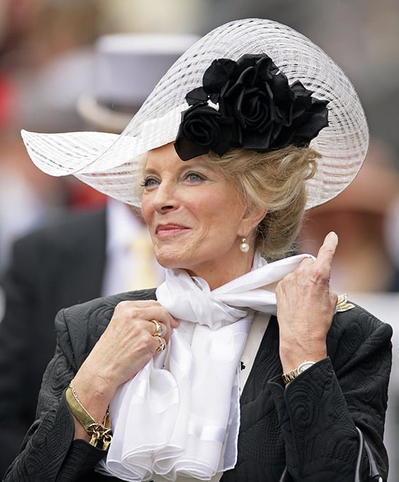 Princess Michael of Kent with hair bun and white cap,