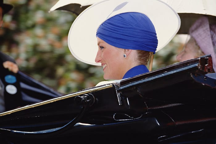 Princess Diana wears blue dress, sitting in a black car