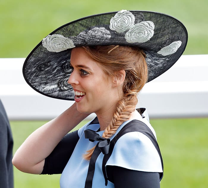 Princess Beatrice with a black hat and braid hairstyle