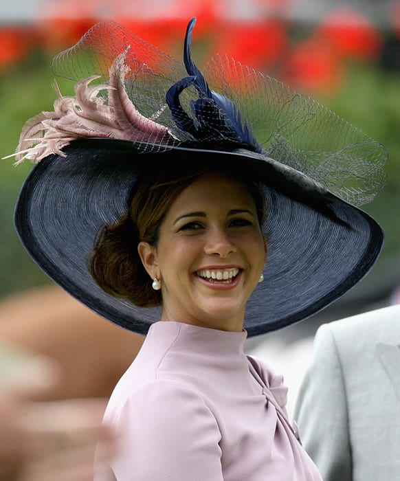 Princess Haya Bint with a black hat and bun hairstyle