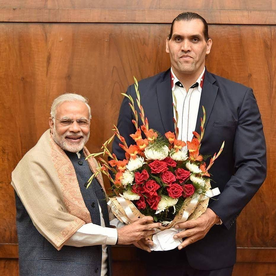 great khali with primer minister of India