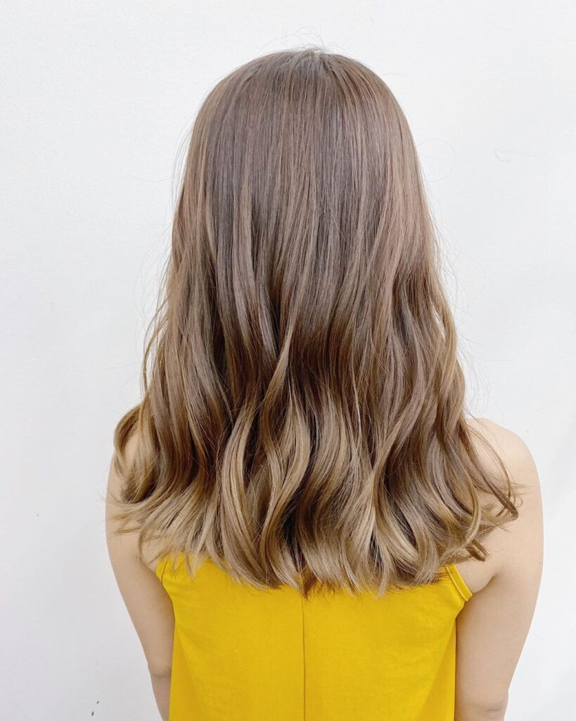Medium Champagne Hair color with Back pose