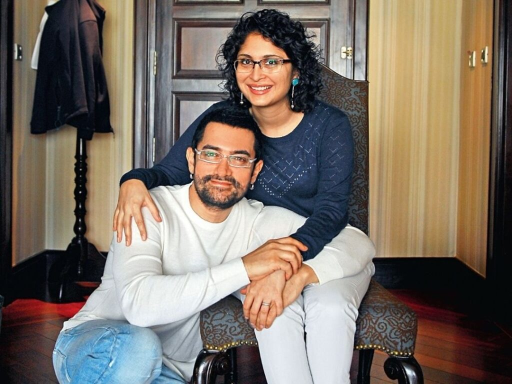 Aamir Khan sitting with ex-wife Kiran Rao and smiling - separated Bollywood couple