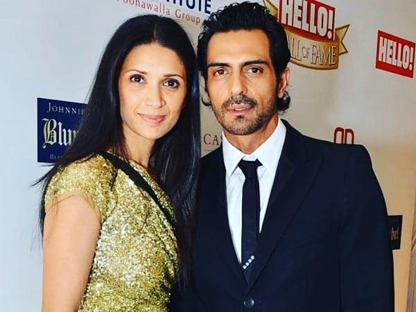 Arjun Rampal posing with wife Mehe Jesia in a public event - celebrity divorce