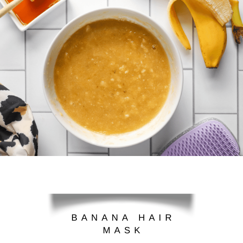 Mashed banana with honey in a white bowl  - hair fall control mask