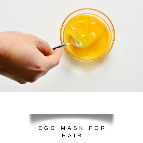 whisking egg yolks with aloe vera gel and olive oil in a bowl - hair fall control mask