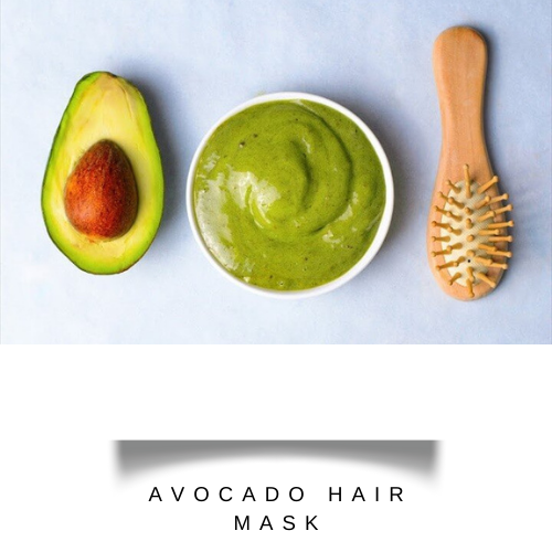 meshed avocado with aloe vera gel and coconut oil in a bowl with a comb - hair fall treatment