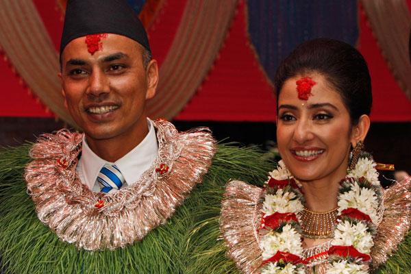Manisha Koirala in wedding dress posing with husband Samrat Dahal - celebrity divorce