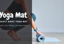 woman is folding her blue color yoga mat - yoga mats
